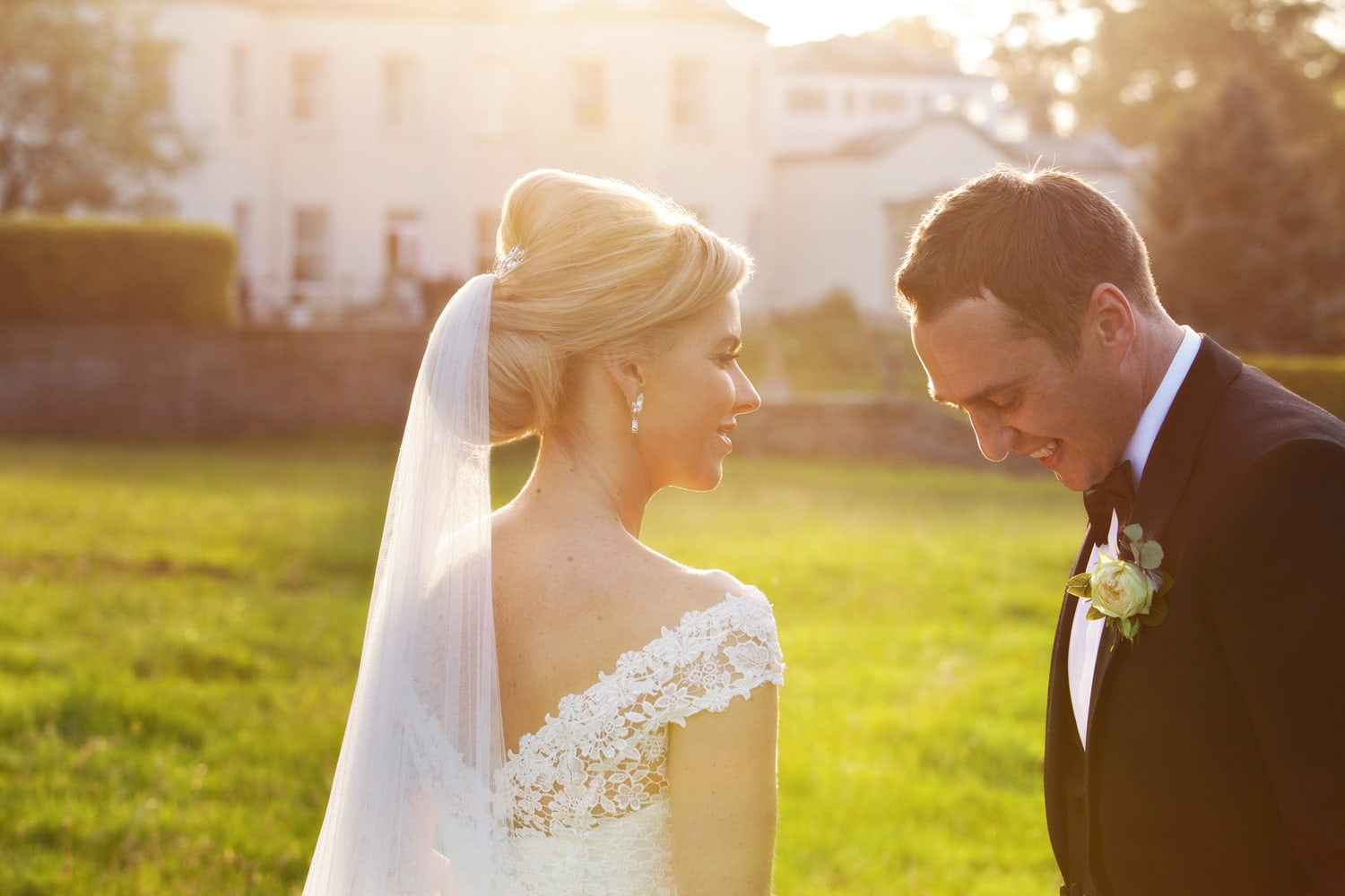 wedding photography Bride and Groom laughing on the lawn at Lartington Hall in the golden hour