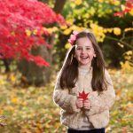 Little girl holding a red leaf at Wynyard Hall