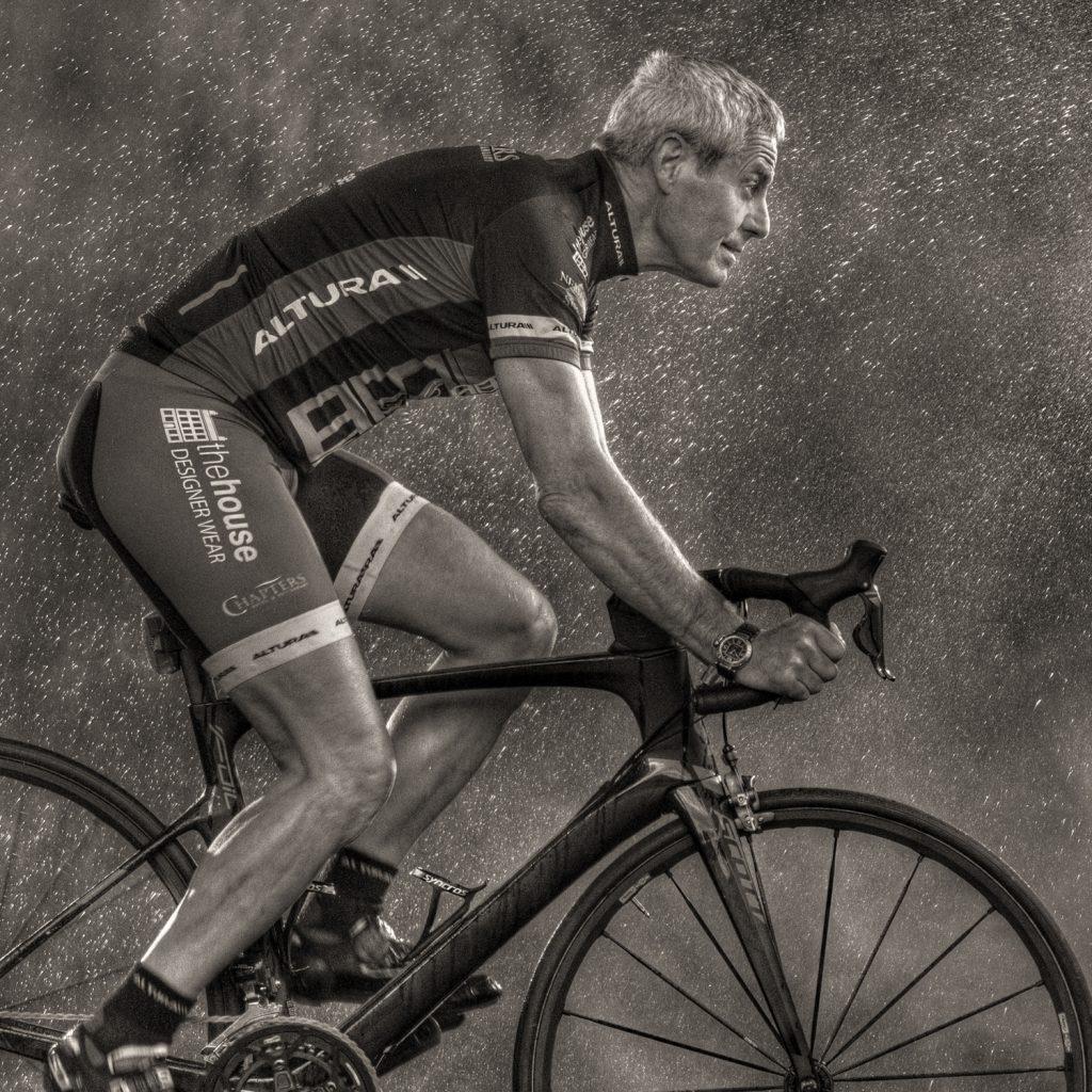 Steven Bell riding his bike in the rain studio session