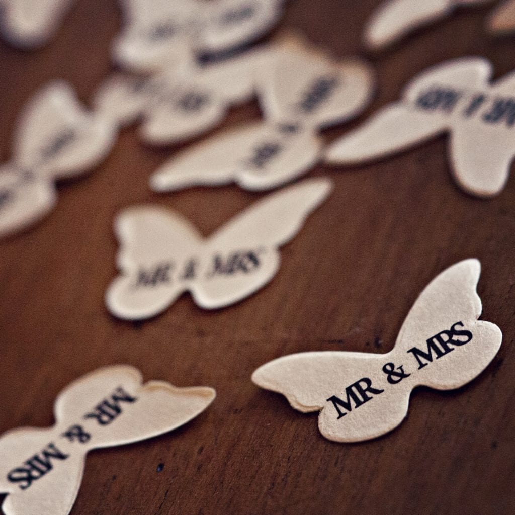 Close up of Mr and Mrs text printed onto a paper butterfly taken at Rudby Hall