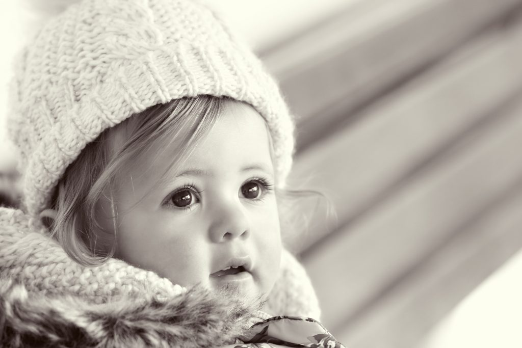 close up portrait of little girl in black and white