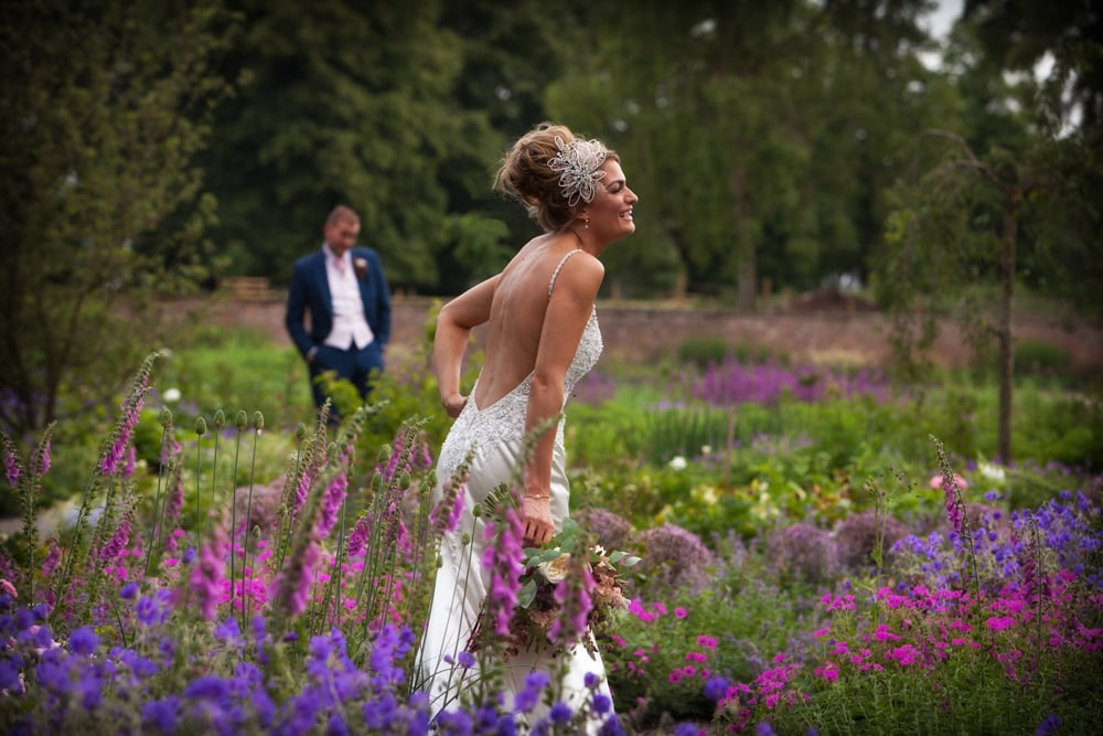Bride laughing in natural garden at Middleton Lodge