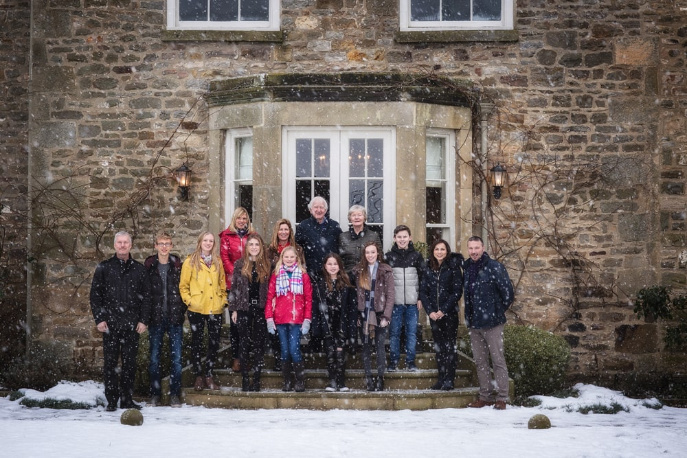 extended family group photograph taken in the snow