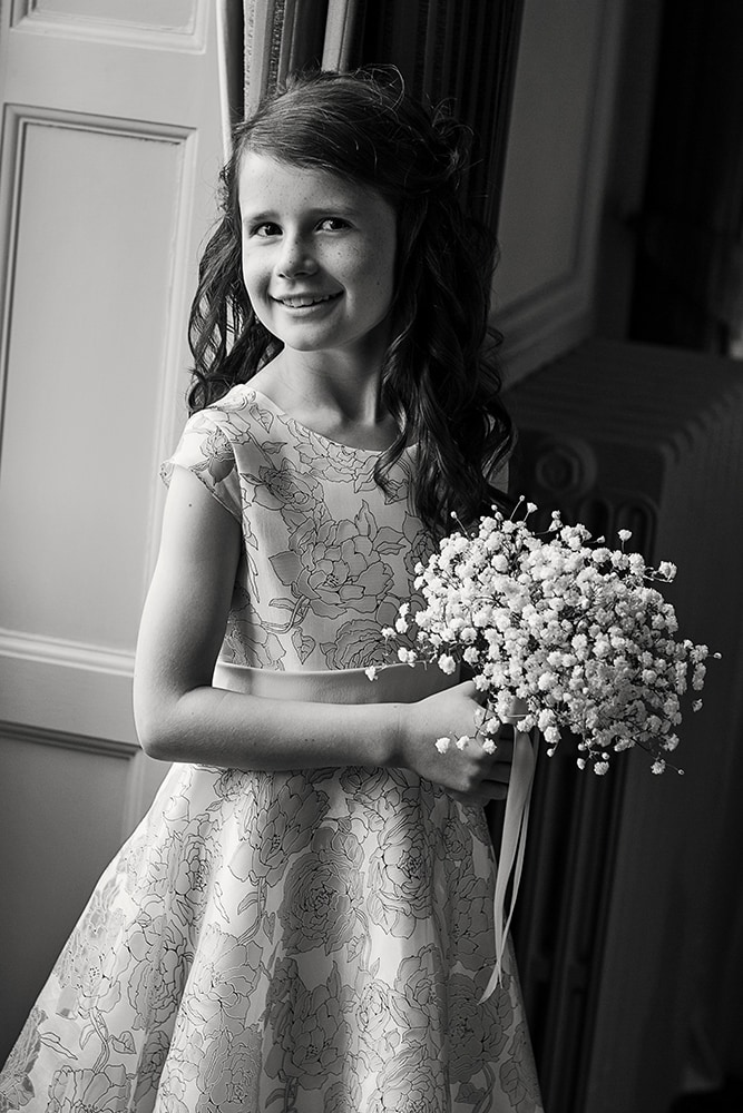 flowergirl photographed at Crathorne Hall using window light