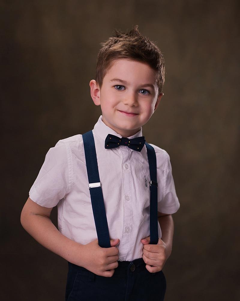 MPA award winner studio portrait of a young boy in braces