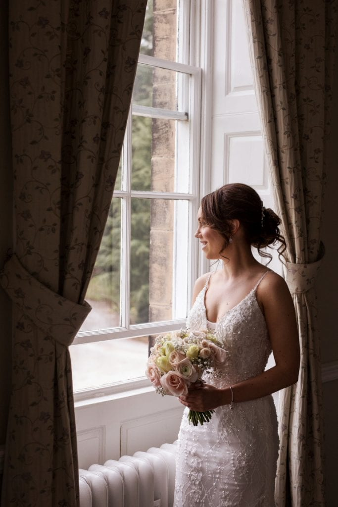 bridal suite at Middleton Lodge with bride looking out of the window