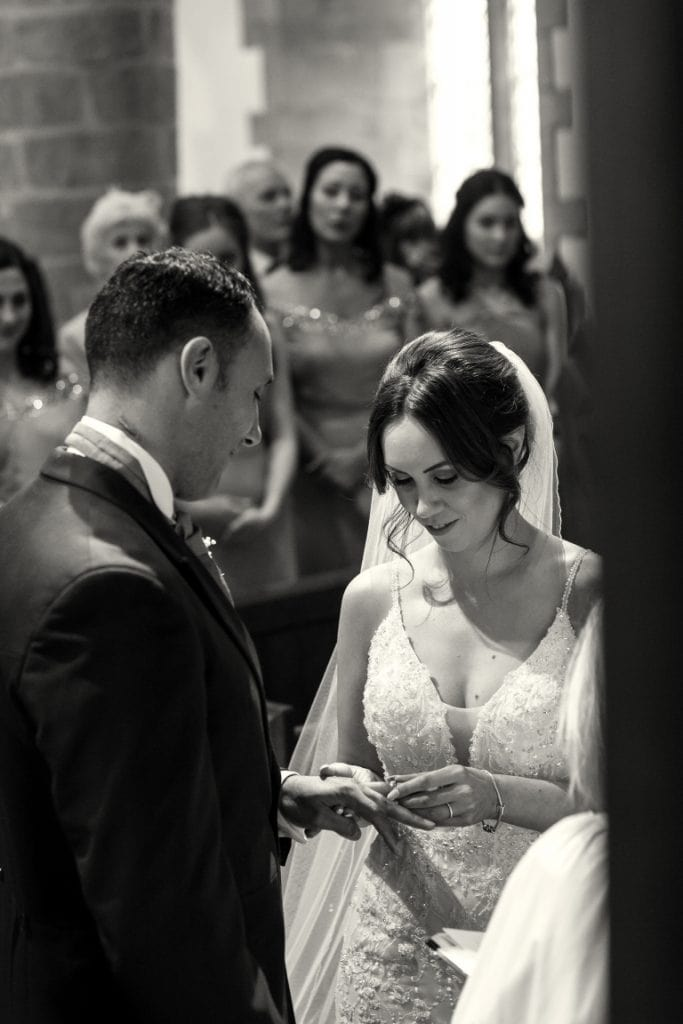 black and white ring exchange image at the alter