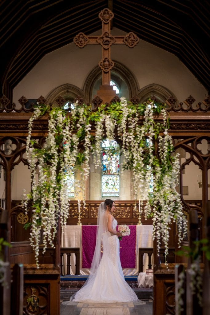 full length portrait of the bride inside church at the alter