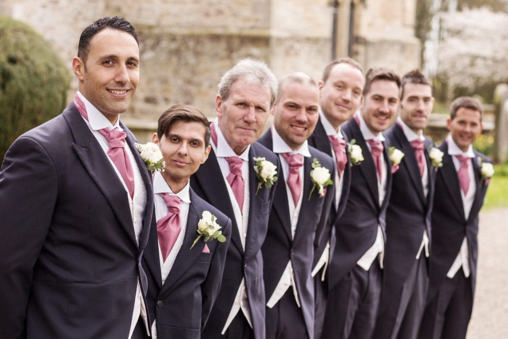 groom and his groomsmen stood in a line