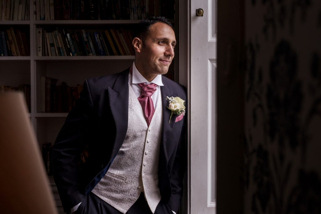 window light image of the groom inside Middleton Lodge