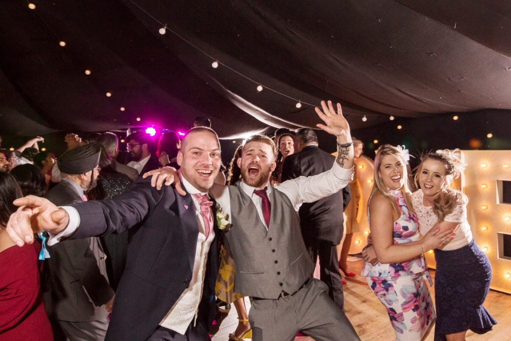 wedding guests having a great time on the dancefloor at Middleton Lodge