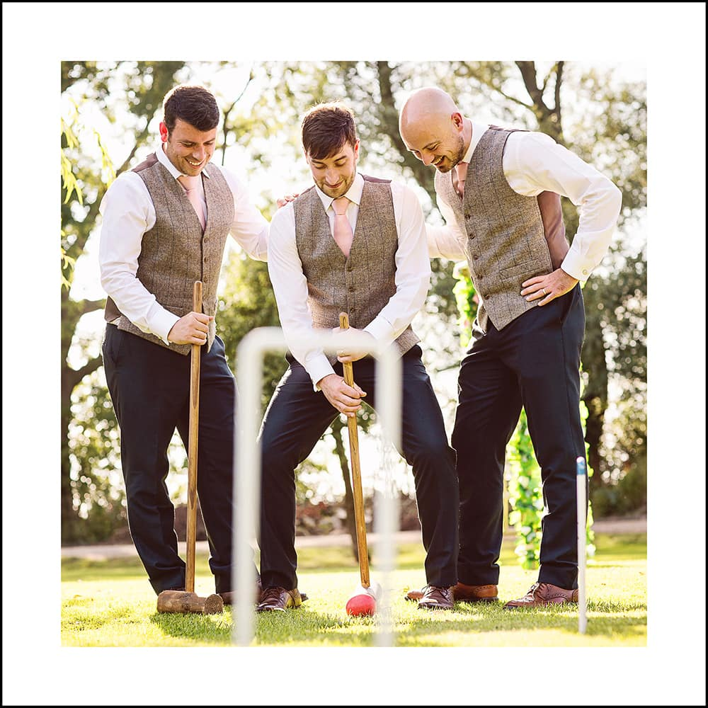 groom and ushers playing croquet on the lawn at whinstone view