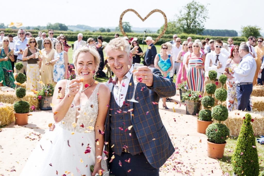 festival wedding confetti and champagne shot