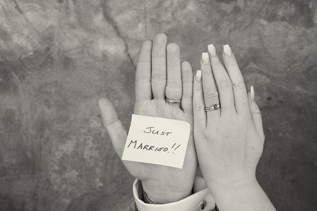 Headlam Hall just married written on a post it and stuck to bride and grooms hands