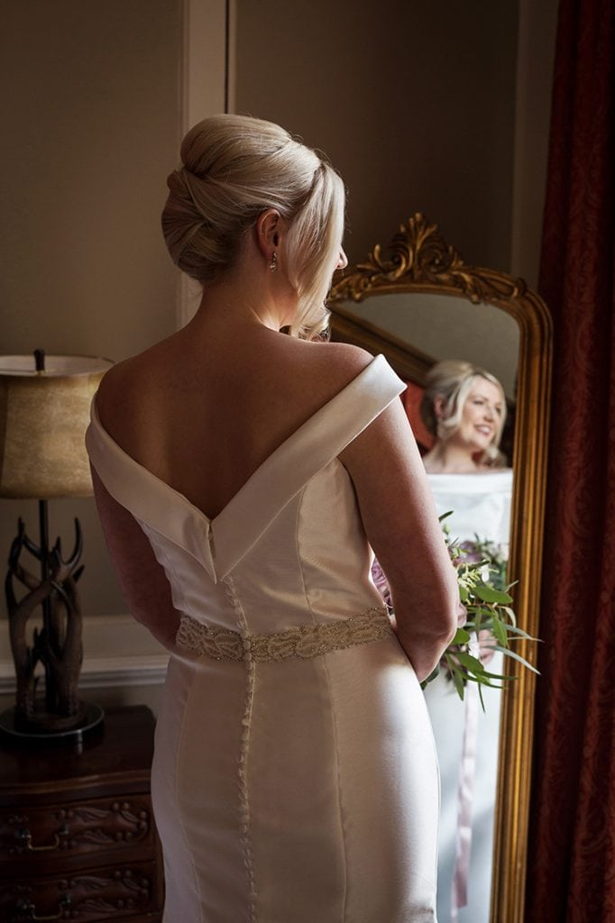 Headlam Hall shot showing the back of the brides dress