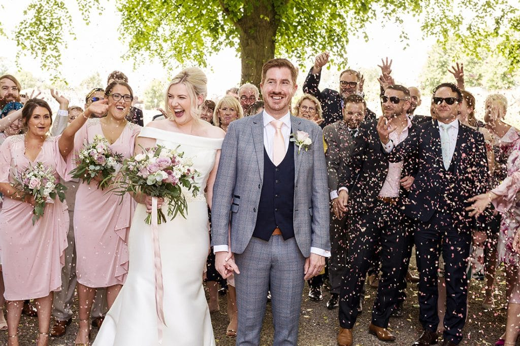 Headlam Hall confetti shot with bride and groom laughing