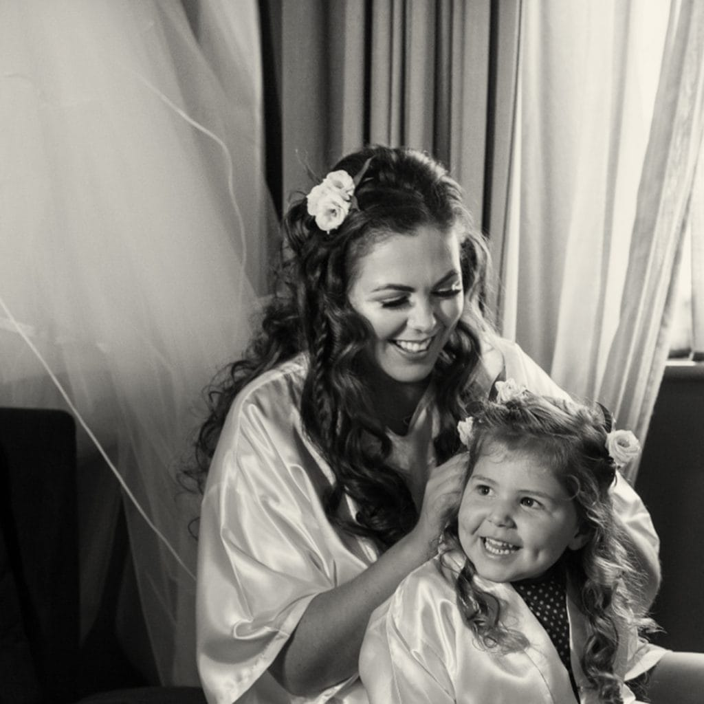 Bride helping her daughter get ready
