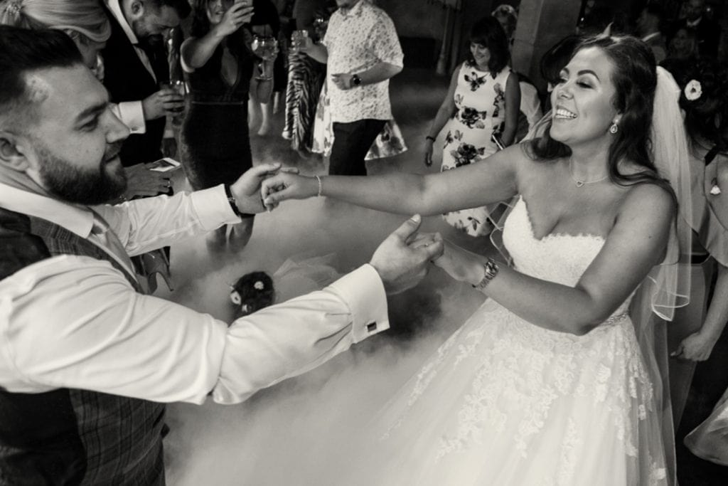 bride and groom dancing to Hip Hop Hooray