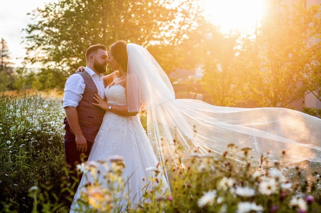bride and groom kissing at sunset at Le Petit Chateau