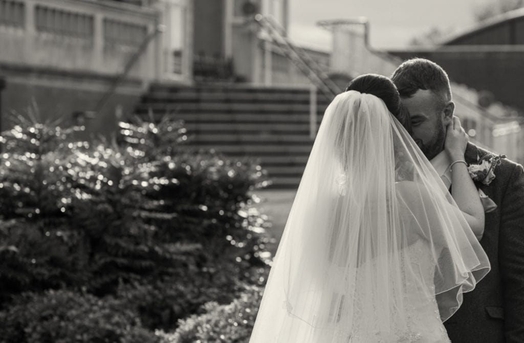 bride and groom embrace outside Rockliffe Hall