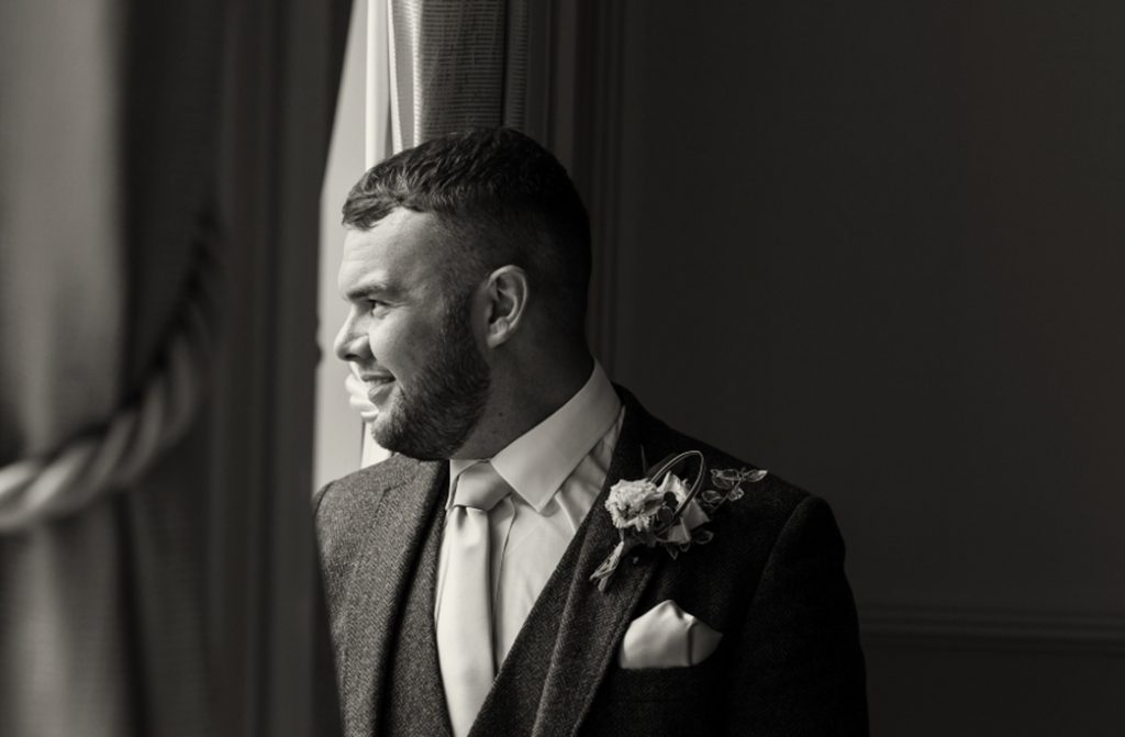 groom looking out of the window at Rockliffe Hall