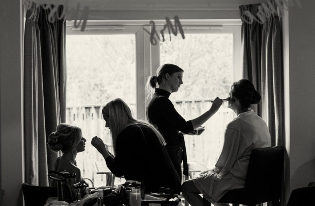 bridesmaids have their make up applied