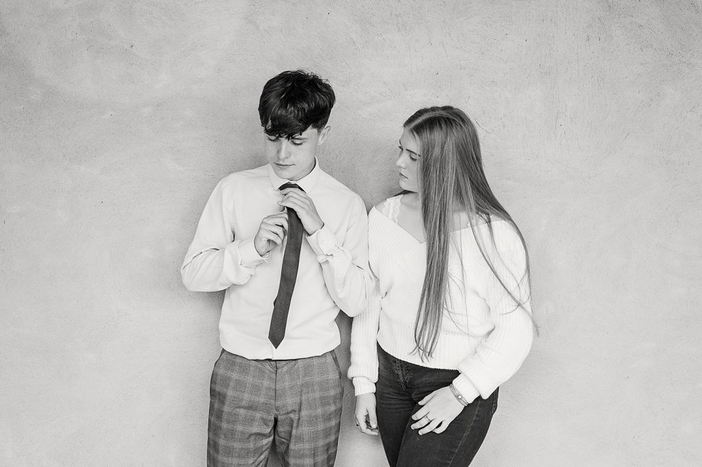 stylish black and white image of a brother an sister