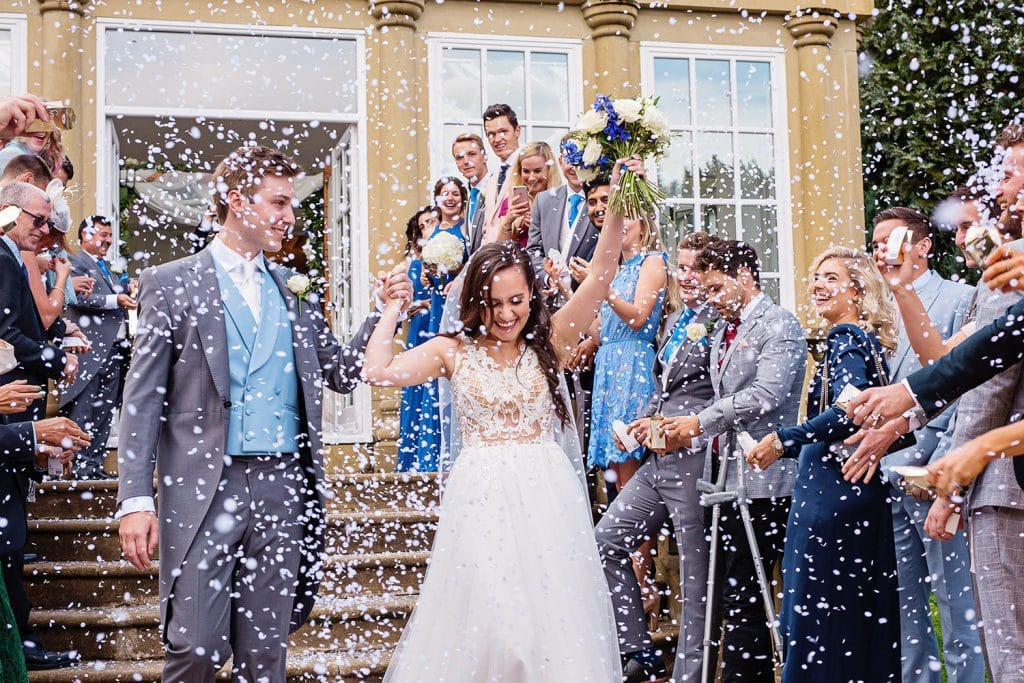 Award Winning North East Wedding Photography Bride and Groom walking out to their guests throwing confetti