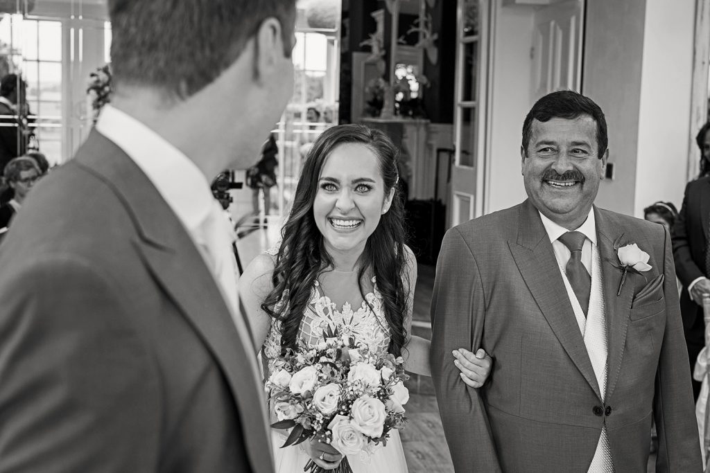 Award Winning North East Wedding Photography Bride walking into the ceremony room with her father.