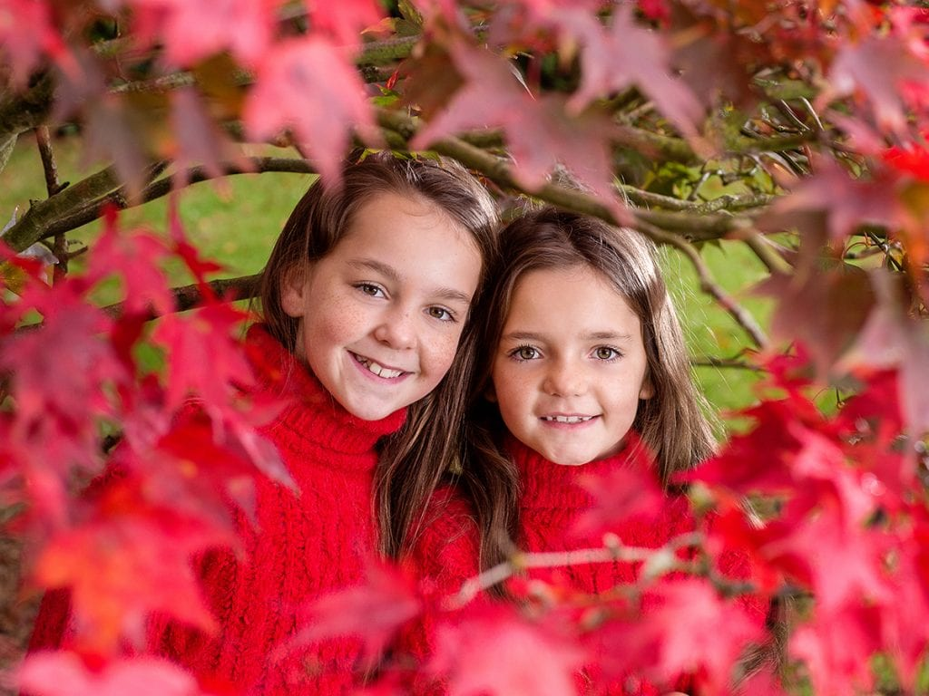 Anyone can take a photo, 2 sisters photographed under an an autumn tree using portable flash at Wynyard Hall gardens.