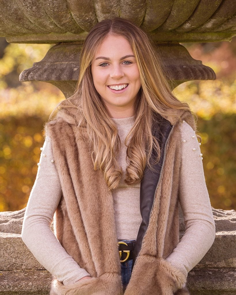 Christmas present portrait, young girl photographed looking relaxed and happy at Wynyard Hall Gardens, beautiful light.  LOcation Portrait Photography