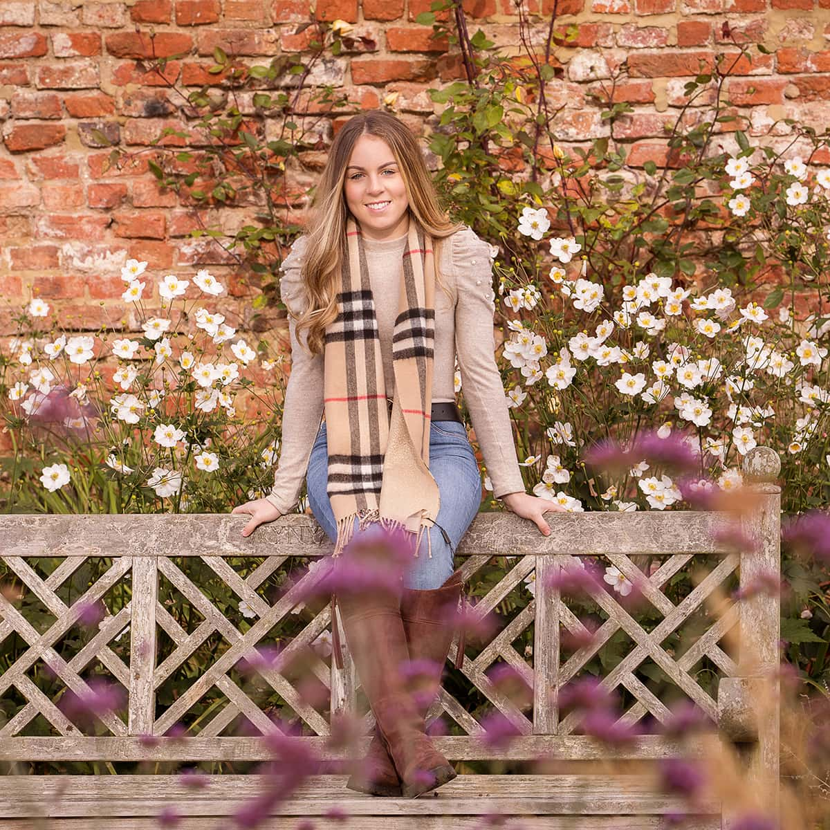 Christmas present portrait, young girl photographed sat on a bench at Wynyard Hall Gardens, beautiful light