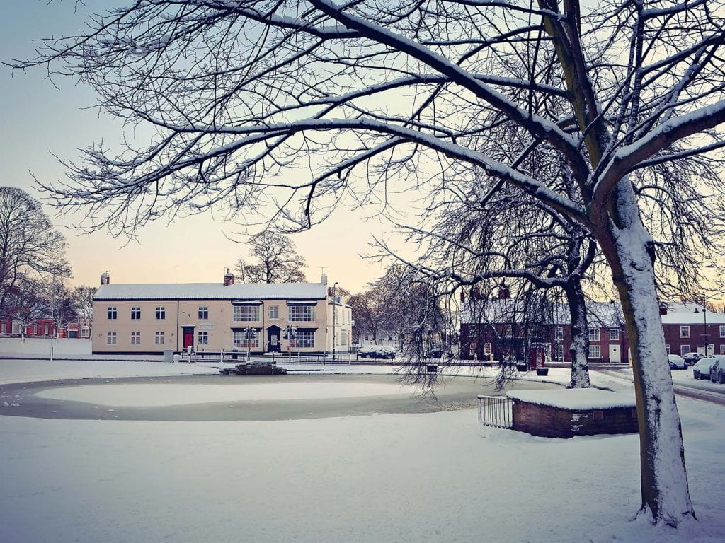 early morning image of Norton Green covered in snow.