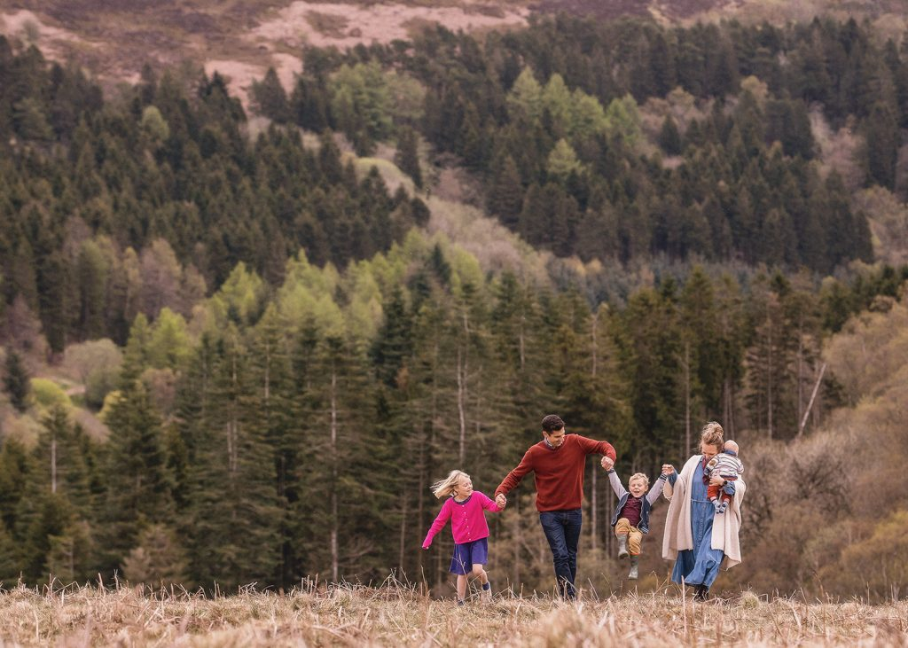 North Yorkshire family holding hands and walking on the moors