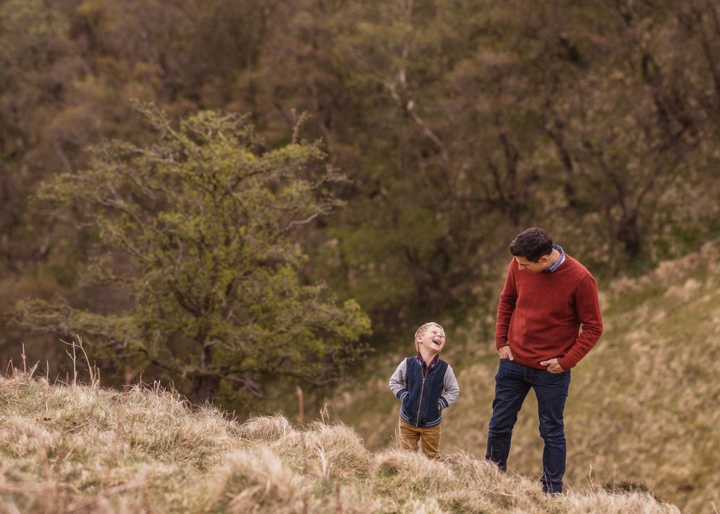 father and son laughing together outdoors on the North Yorkshire Moors