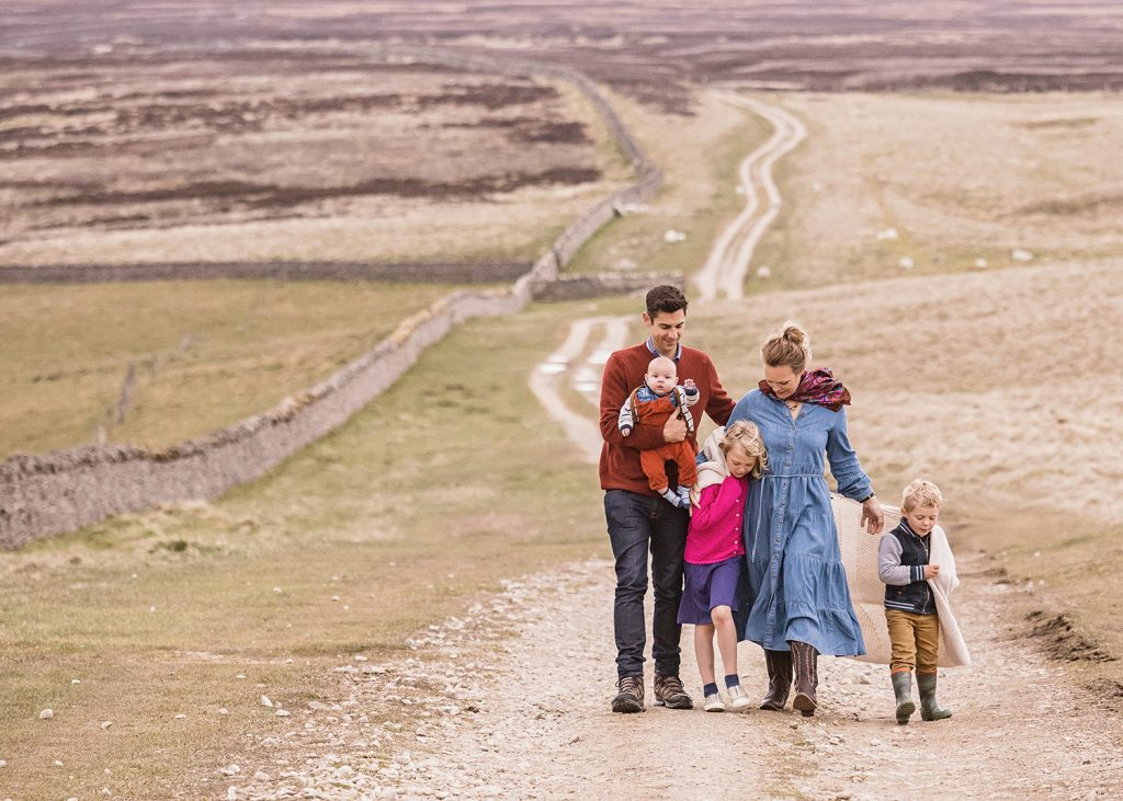 family of 5 walking down a farm track on the North Yorkshire Moors